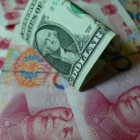China's currency could double losses this year - economists